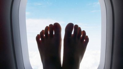 Aggressive shoeless feet on airplane traumatize fellow travelers