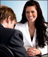 Interviewing-Woman-White-Suit
