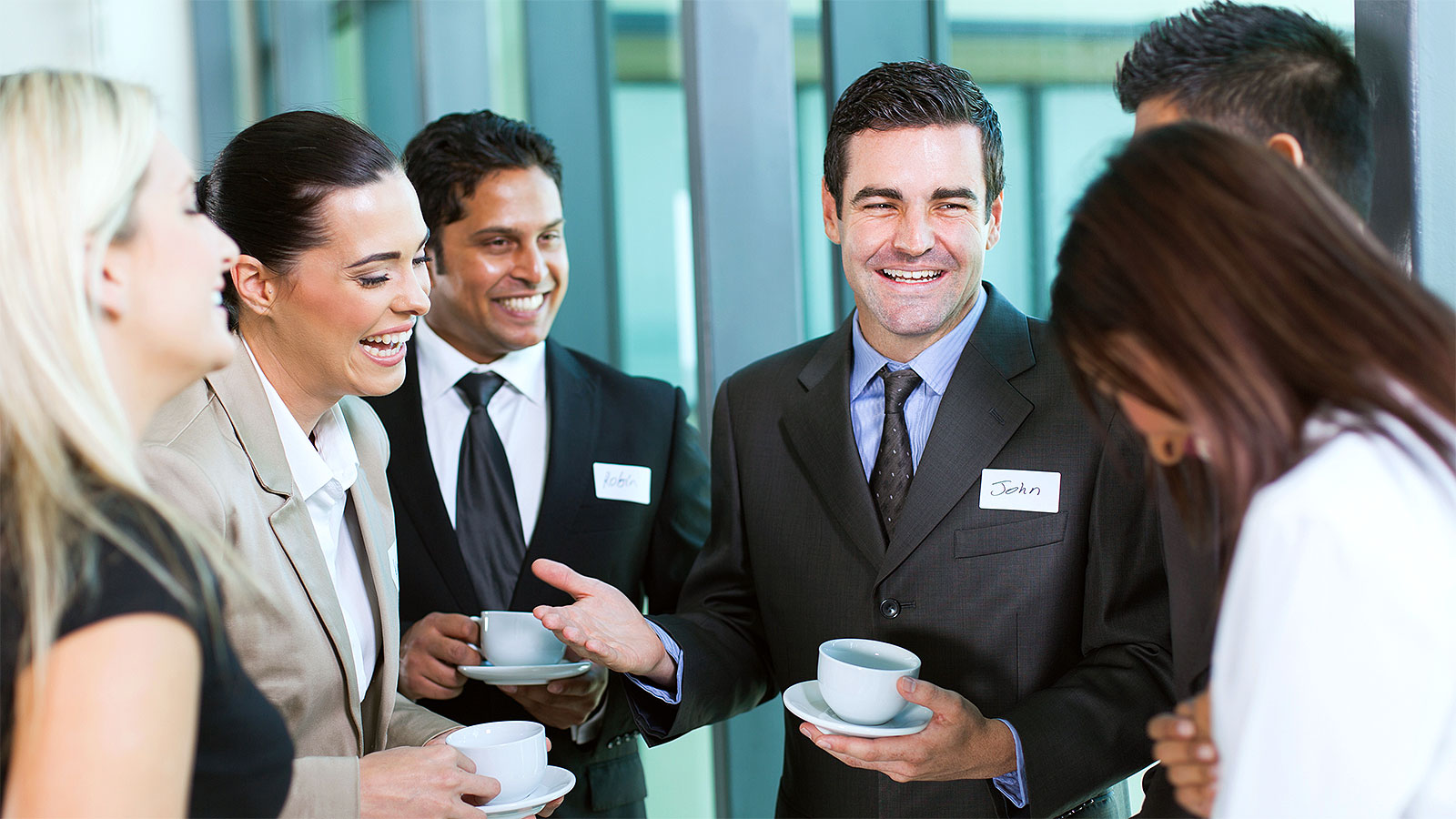 5 tips for improving your networking skills from professionals who've mastered it