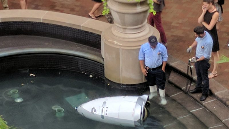 Sad robot takes dip in a fountain